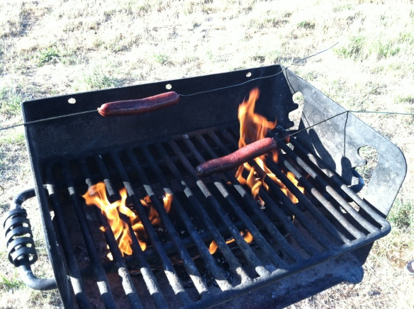 Grilling up some hotdogs.