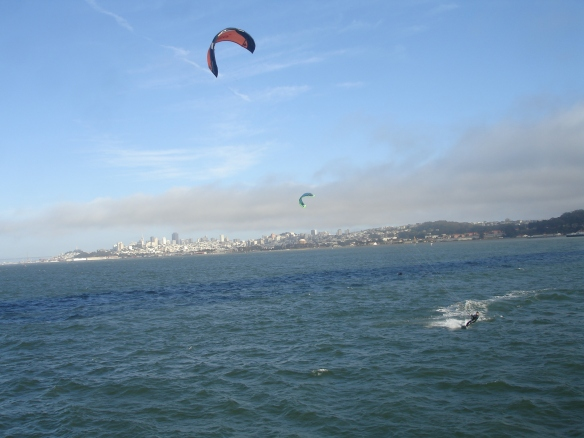 All of these wind surfers (What do you call this?) were zooming around beside us.